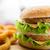 close up of hamburger or cheeseburger on table stock photo © dolgachov