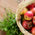 close up of basket with apples and herbs on table stock photo © dolgachov