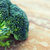 close up of broccoli on wooden table stock photo © dolgachov