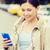 улыбающаяся · женщина · смартфон · такси · город · путешествия · командировка - Сток-фото © dolgachov