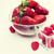 close up of ripe red strawberries and raspberries stock photo © dolgachov