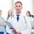uśmiechnięty · mężczyzna · lekarz · schowek · stetoskop · muzyka · zawód - zdjęcia stock © dolgachov
