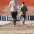close up of couple running downstairs on stadium stock photo © dolgachov