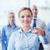 smiling businesswoman pointing finger on you stock photo © dolgachov