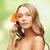 lovely woman with gerbera flower stock photo © dolgachov