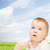 curious baby looking up stock photo © dolgachov