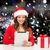 smiling woman in santa hat with gift and tablet pc stock photo © dolgachov
