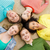 group of smiling people lying down on floor stock photo © dolgachov