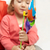 happy little girl with mother holding pinwheel toy stock photo © dolgachov