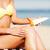 girl putting sun protection cream on beach chair stock photo © dolgachov