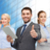 group of smiling businessmen showing thumbs up stock photo © dolgachov
