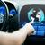 man hand pointing finger to car monitor with globe stock photo © dolgachov