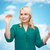 smiling woman choosing between apple and cookie stock photo © dolgachov