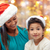 happy mother and little girl in santa hats stock photo © dolgachov