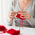 woman hands knitting with needles and yarn stock photo © dolgachov
