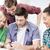 students looking at smartphone stock photo © dolgachov