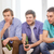 happy male friends with beer watching tv at home stock photo © dolgachov