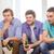 три · друзей · гостиной · Смотря · телевизор · улыбаясь · человека - Сток-фото © dolgachov