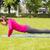 smiling woman doing doing push-ups on mat outdoors stock photo © dolgachov