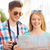 smiling couple with map and photo camera in city stock photo © dolgachov