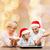 happy family in santa helper hats cooking stock photo © dolgachov