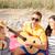 grupo · feliz · amigos · jugando · guitarra · playa - foto stock © dolgachov