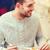 fiatalember · ebédlő · jóképű · férfi · pezsgő · üveg · luxus - stock fotó © dolgachov