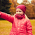 happy little girl pointing finger in autumn park stock photo © dolgachov
