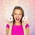 atrakcyjny · młoda · kobieta · jedzenie · pączek · różowy · młodych - zdjęcia stock © dolgachov