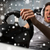 man playing car racing video game with wheel stock photo © dolgachov