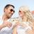 smiling couple in sunglasses drinking wine in cafe foto stock © dolgachov