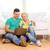 couple with laptop sitting on floor in new house stock photo © dolgachov