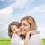 feliz · sonriendo · madre · hija · cielo - foto stock © dolgachov