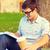 teenager reading book with take away coffee stock photo © dolgachov