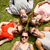 group of smiling friends lying on grass outdoors stock photo © dolgachov