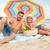 счастливым · семьи · пляж · песок - Сток-фото © dolgachov