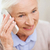 senior woman with smartphone calling at home stock photo © dolgachov