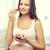 feliz · mujer · embarazada · comer · frutas · casa · embarazo - foto stock © dolgachov