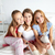 teen girls with selfie stick photographing at home stock photo © dolgachov