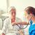 arts · verpleegkundige · senior · vrouw · ziekenhuis · geneeskunde - stockfoto © dolgachov