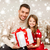 smiling father and daughter holding gift box stock photo © dolgachov