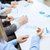 zakenlieden · werken · grafieken · financiële · business · vergadering - stockfoto © dolgachov