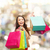 smiling woman with colorful shopping bags stock photo © dolgachov