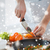 close up of man cutting vegetables with knife stock photo © dolgachov