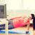 smiling teenage girl doing side plank at home stock photo © dolgachov