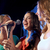 happy young women singing karaoke in night club stock photo © dolgachov
