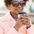smiling african american woman drinking coffee stock photo © dolgachov