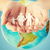 human hands holding paper family over earth globe stock photo © dolgachov