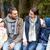 szczęśliwą · rodzinę · posiedzenia · ławce · mówić · obozu · kemping - zdjęcia stock © dolgachov