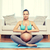happy pregnant woman meditating at home stock photo © dolgachov